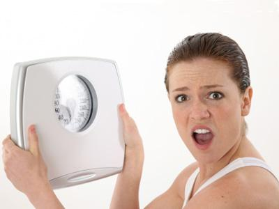 Woman-upset-with-scale--diet--weight-loss---26752567